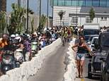 Border chaos: Hundreds of motorists stand in the sweltering heat