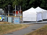 Murder investigation: Police set up two forensic tents in Gloucester today as they probe the killing of a man, aged in his 50s, who was found with stab wounds
