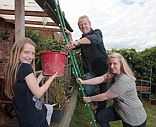 Buy-to-let brigade: Malcolm Castle is helped by daughters Charlotte and Kate