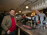 First to the bar: Tom from Beaconsfield was the first customer to have a pint at the pub this morning at 9.21am