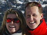 Support act: Schumacher's wife Corinna insists her husband is a 'fighter' who will not give up
