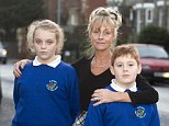 Soaked: Debbie Pugh and her daughter Emma, 11 and son David, eight, were drenched by a passing motorist, who was may be prosecuted for careless driving