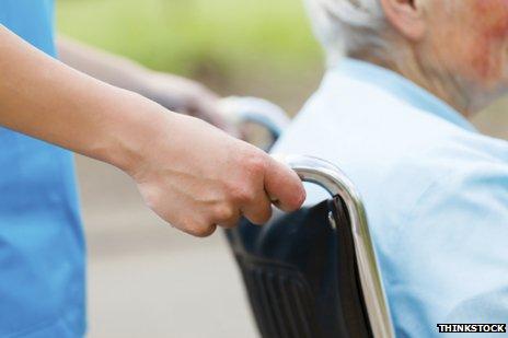 carer pushing wheelchair
