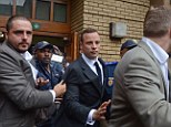 Oscar Pistorius is pictured leaving court after the first day of his murder trial