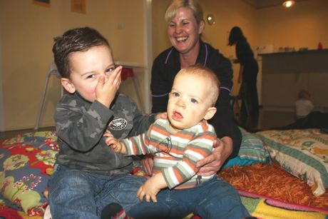 Olive Tree Children's Centre carer Debbie Catling with brothers Lachlan (left) and Mitchell Sullivan who are recovering from a particularly sloppy kiss.